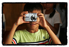 boy taking photograph